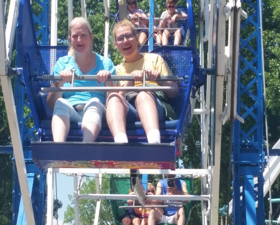 Covey kids smile on the ferries wheel at bay beach.