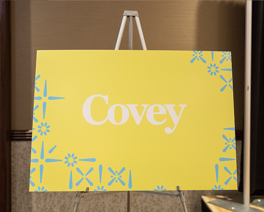 A yellow bag with Covey on it showing everyone the new Covey way.