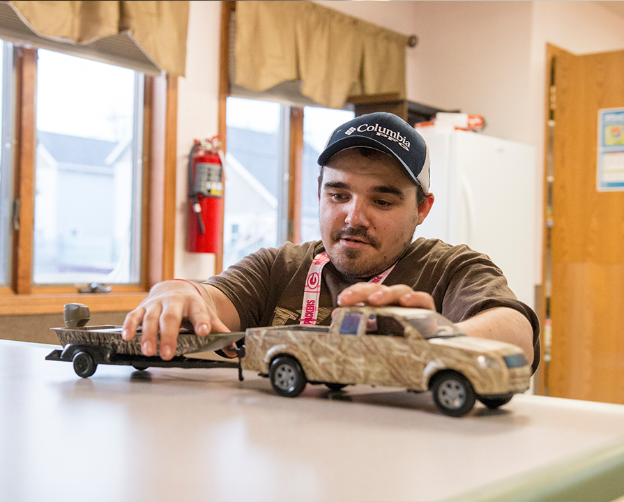 A covey client playing with a toy truck.