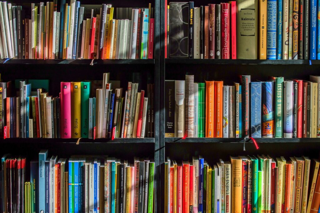 A bookshelf filled with colorful books.