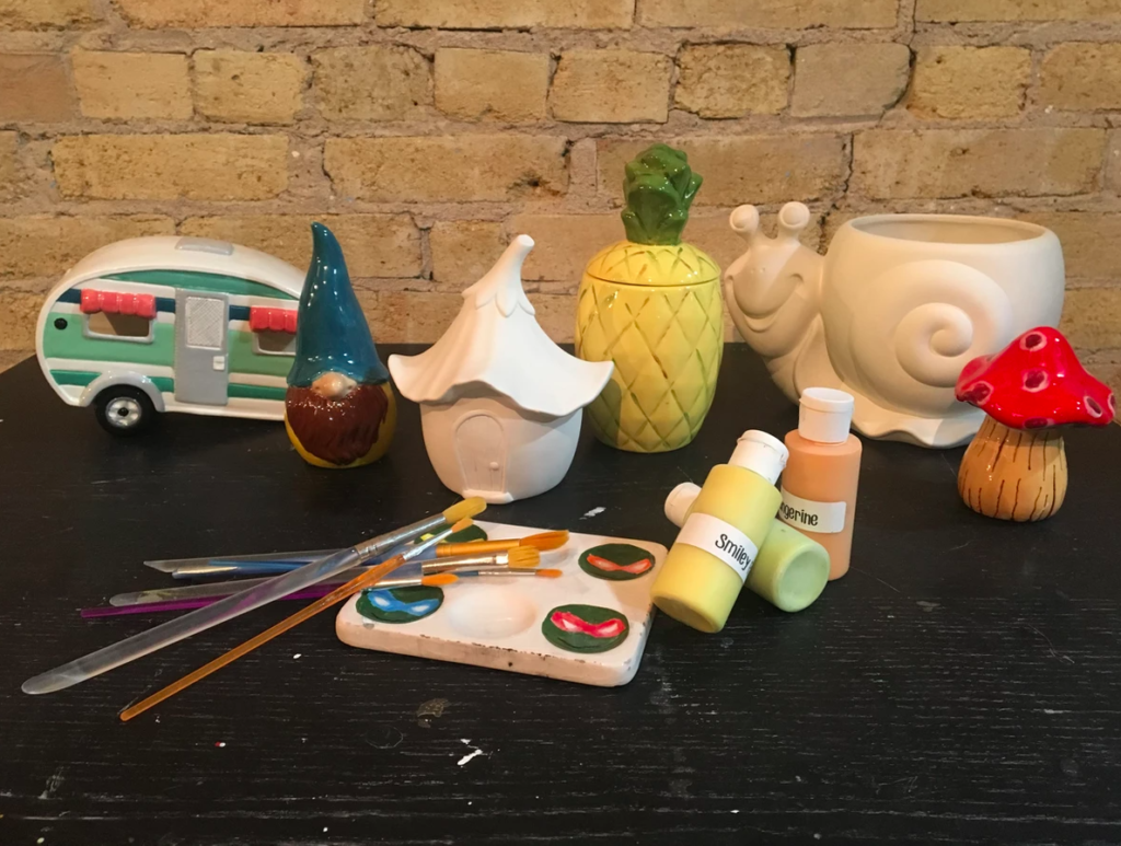 A table of pottery painting supplies at Fire Escape.
