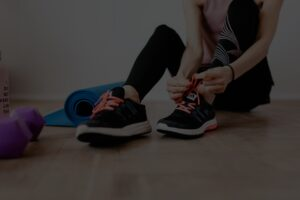 A girl tying her shoes.