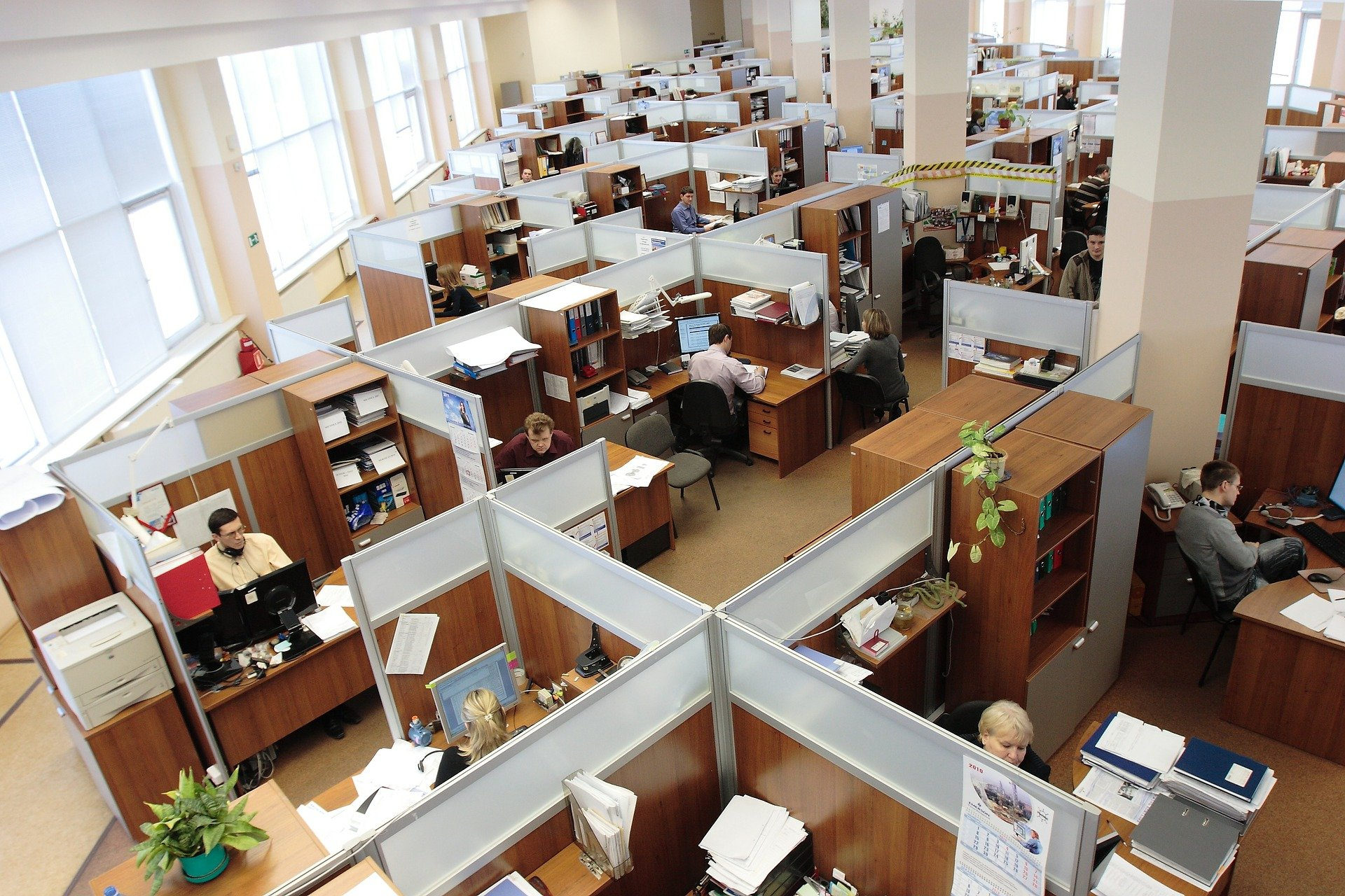 An overhead shot of an office with cubicles.