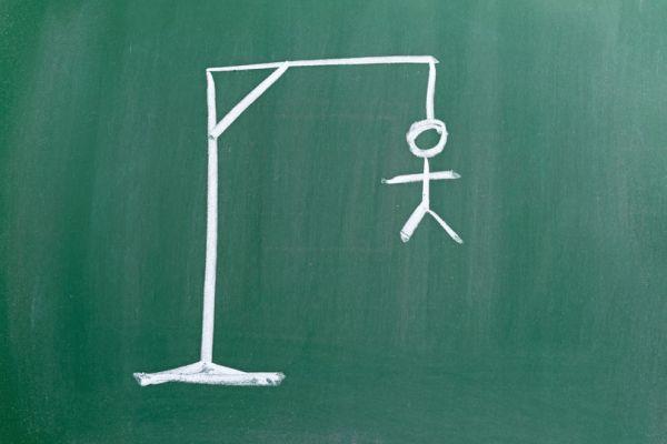 Hangman written on a chalk board.