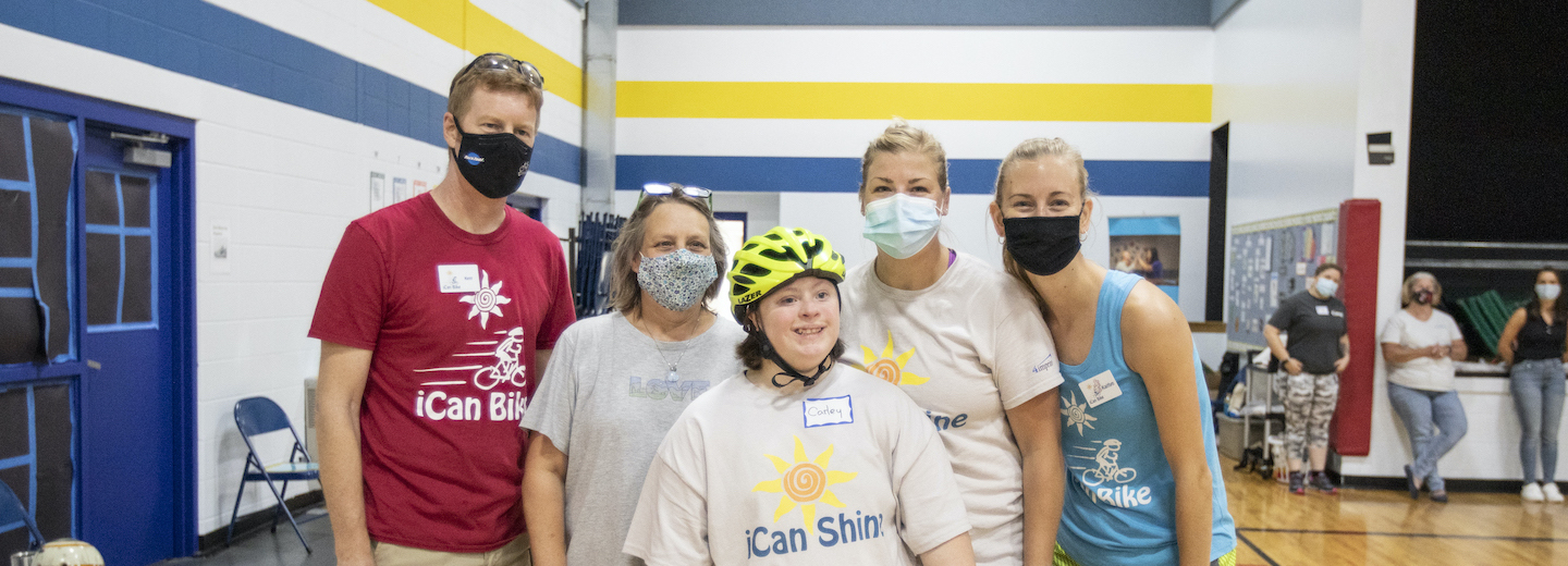 A group shot of ican shine bike camp participates and volunteers smiling.